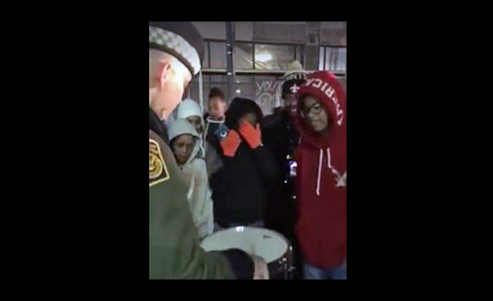 Video: Federal officer, student musician have drum battle on streets of New Orleans during Mardi Gras _lowres