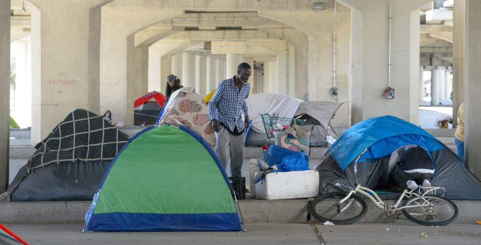 Video: Homeless New Orleans man to 'y'all ... on the Internet': 'We need houses! C'mon help us'; fence plan to close camp _lowres