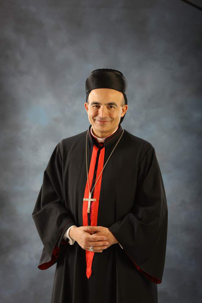 Catholic group seeks bigger place for priest, to assist community _lowres