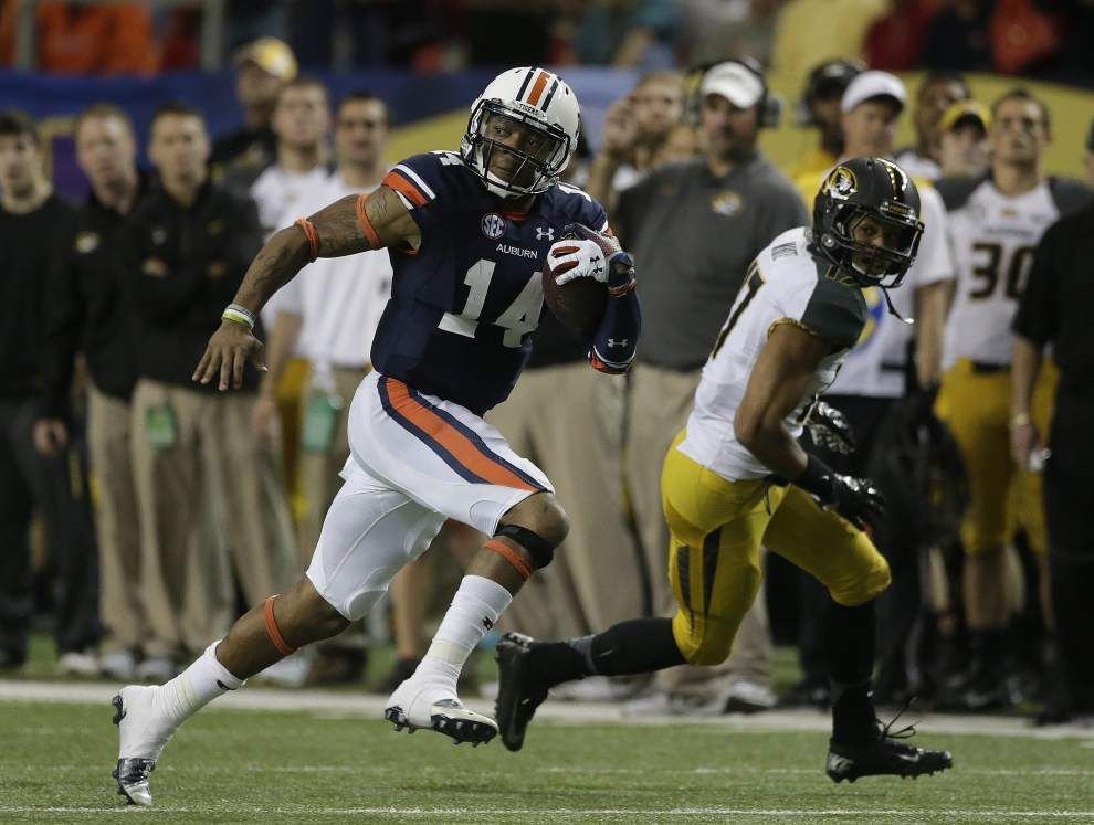 With a puff of smoke, Auburn's Nick Marshall disappeared from SEC media days _lowres