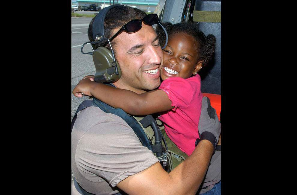 Rescuer and 'mystery girl' will finally be reunited 10 years after iconic Hurricane Katrina photo _lowres