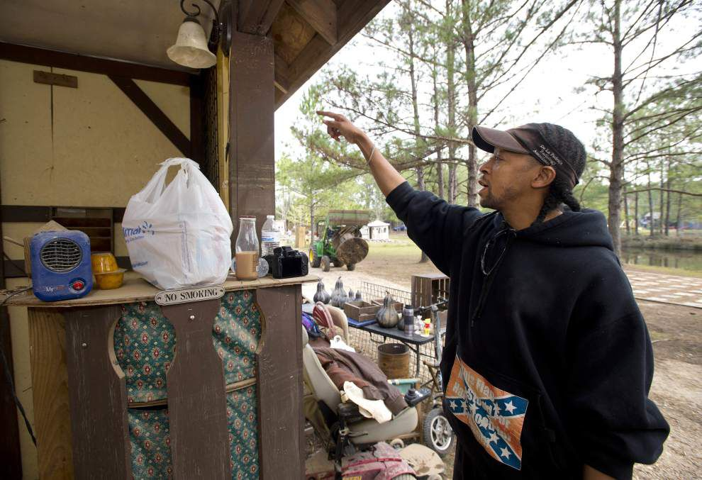 In labor of love, volunteers clean up mud, debris at flooded Louisiana Renaissance Festival site _lowres