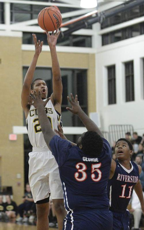 U-High guards Jalen Johnson and D.J. White doing what it takes to win _lowres