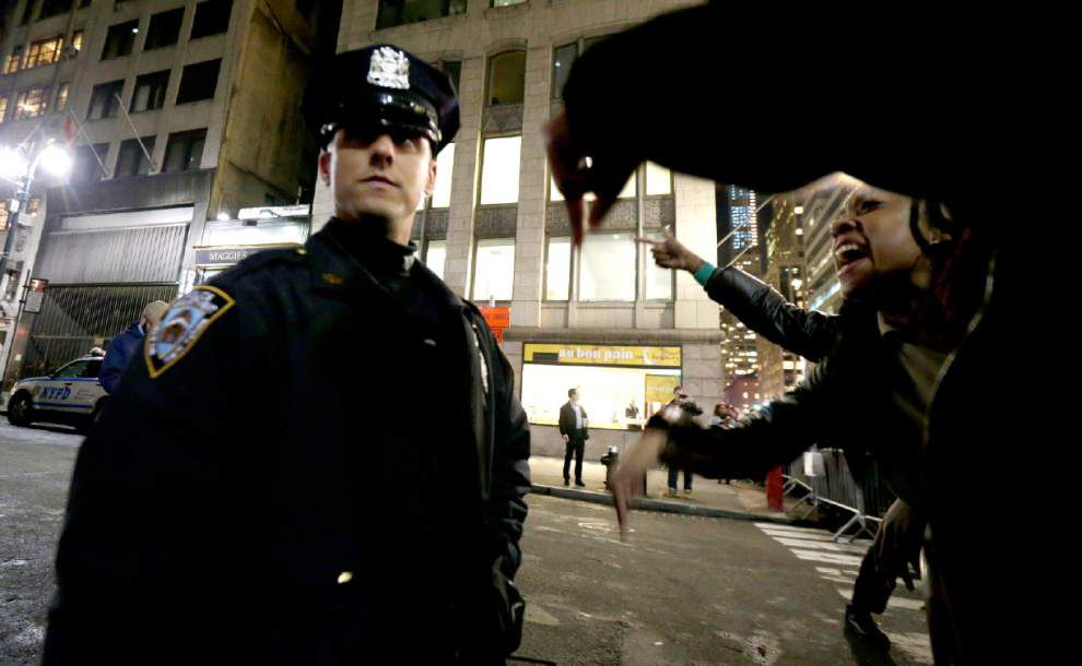 Protests erupt as cop cleared; feds to investigate _lowres