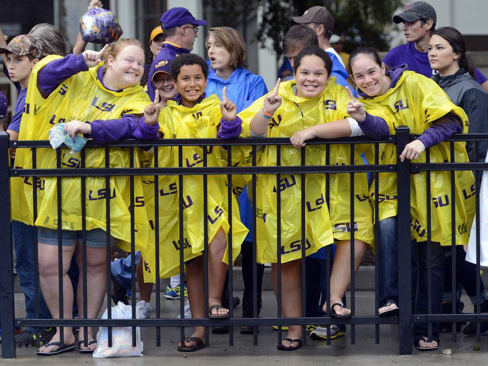 Watch people playing, cheering, having fun in rain before LSU's victory vs. Western Kentucky at Tiger Stadium _lowres
