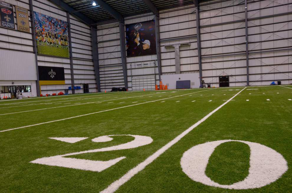 Saints unveil photo of Tom Benson at practice facility; coach Sean Payton says, 'He has one goal every year: to win a championship for our fans' _lowres