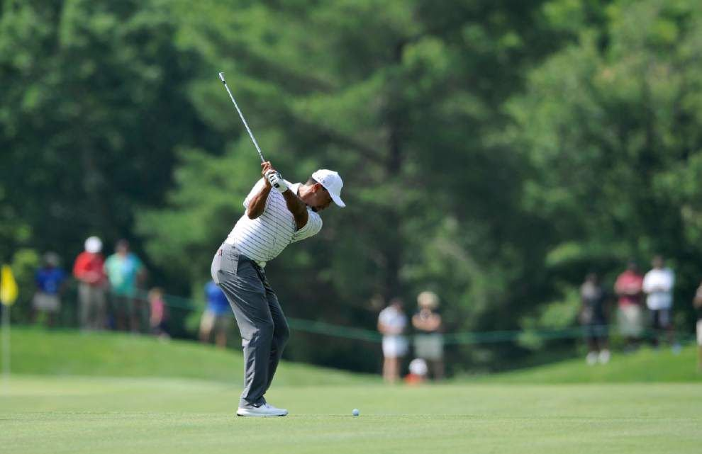 Tiger Woods raises energy level on PGA Tour _lowres