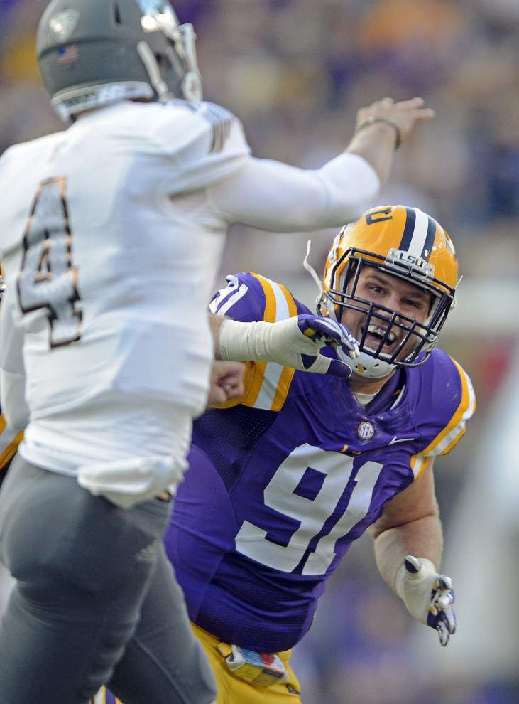 Les Miles praises Brandon Harris, Malachi Dupre for helping stranded motorists on Sunday: 'There's a lot of real quality people on this team' _lowres