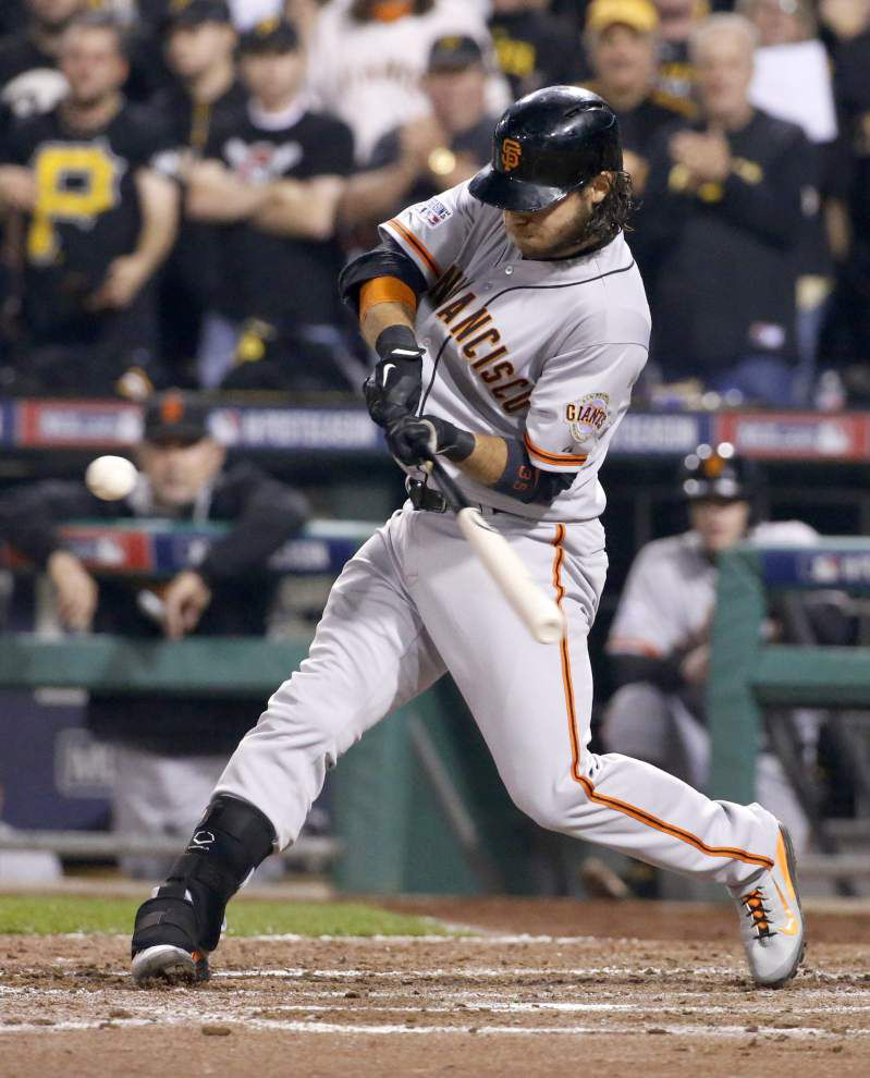 Crawford's slam sparks Giants to wild-card victory _lowres
