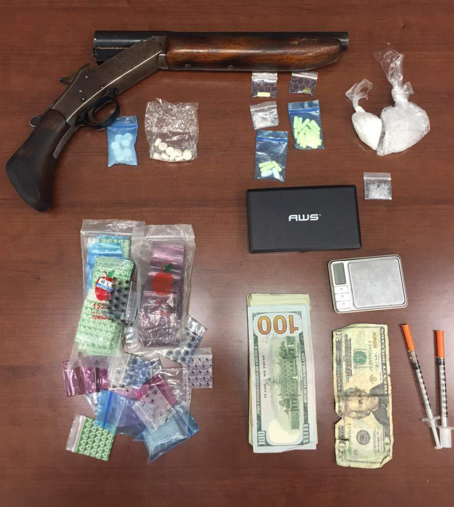 Three booked in Livingston Parish after raid nets drugs, counterfeit cash and a sawed-off shotgun _lowres