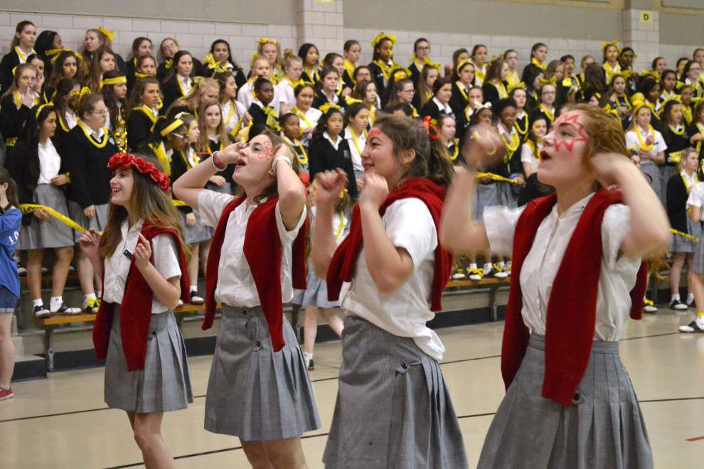 Spirits soar at St. Mary's Dominican High School bleacher swap _lowres