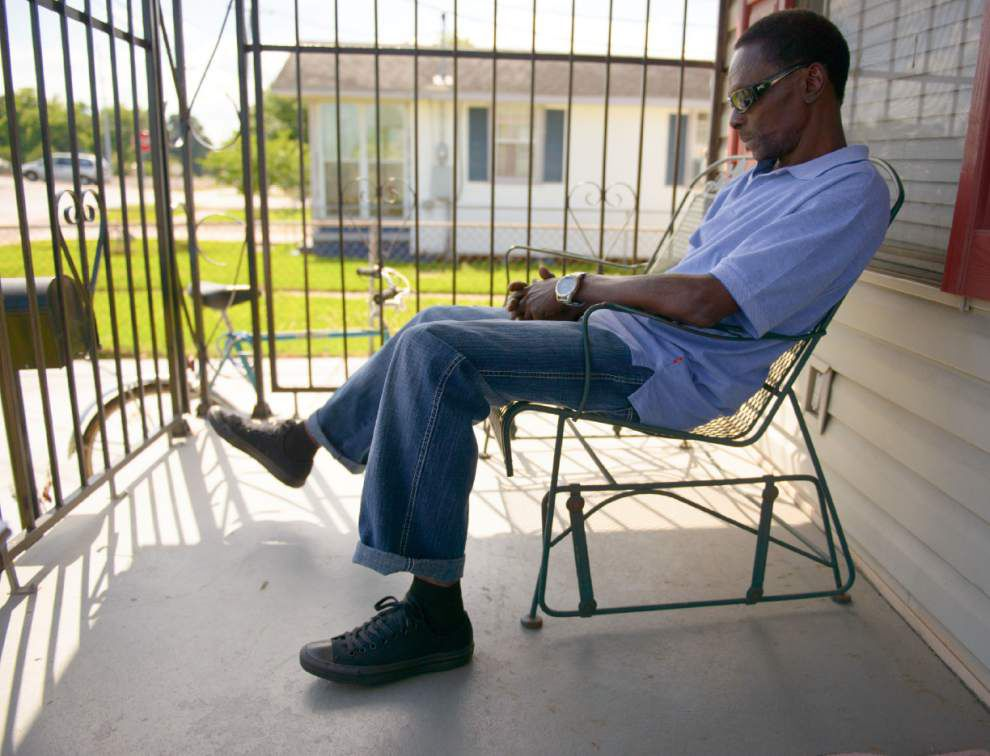 Reginald Adams, free after 34 years, takes to his mother's porch _lowres