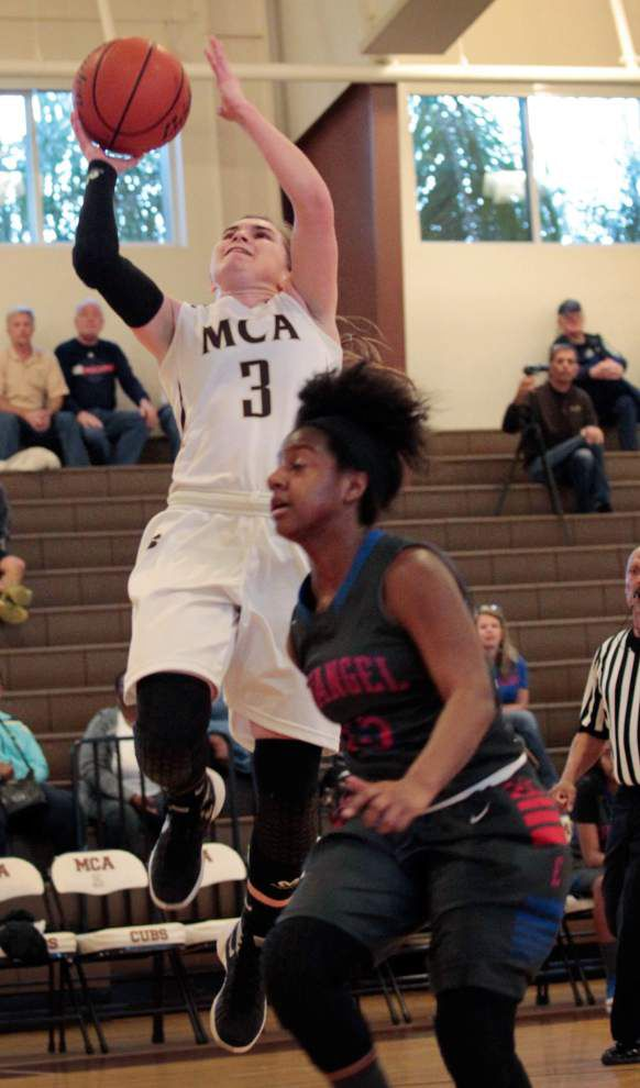 Mount Carmel cruises over Evangel in first round of girls basketball playoffs _lowres