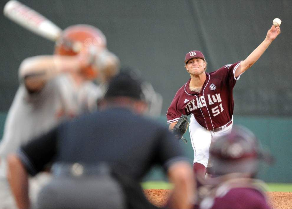 Texas A&M, Texas to play winner-take-all game in Houston _lowres