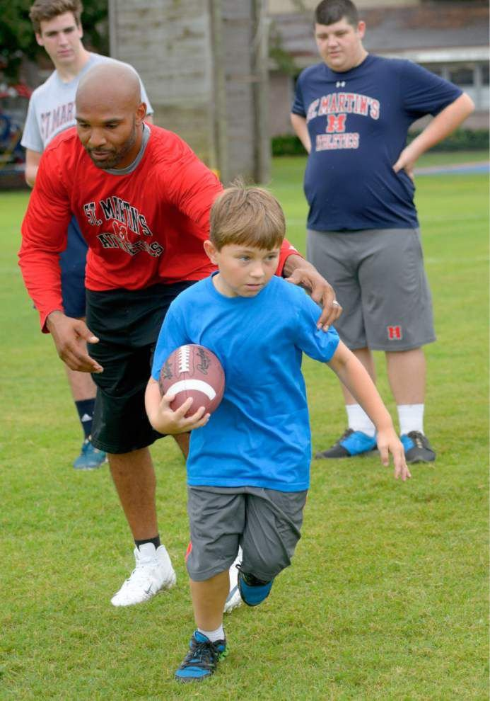 Matt Forté looms large at St. Martin's football camp _lowres