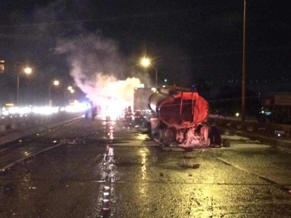 Two 18-wheelers in early-morning fiery crash shuts down I-110 South for hours _lowres
