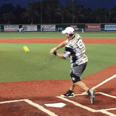 Drew Brees loses home run crown to Justin Drescher at Celebrity Black and Gold softball game _lowres