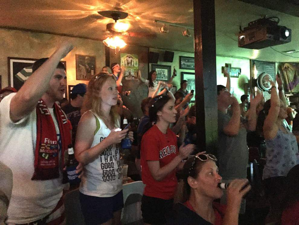 New Orleans fans scream their approval while watching the U.S. wins Women's World Cup _lowres