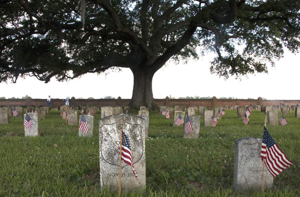 Volunteers place flags to remember fallen at Chalmette Cemetery _lowres