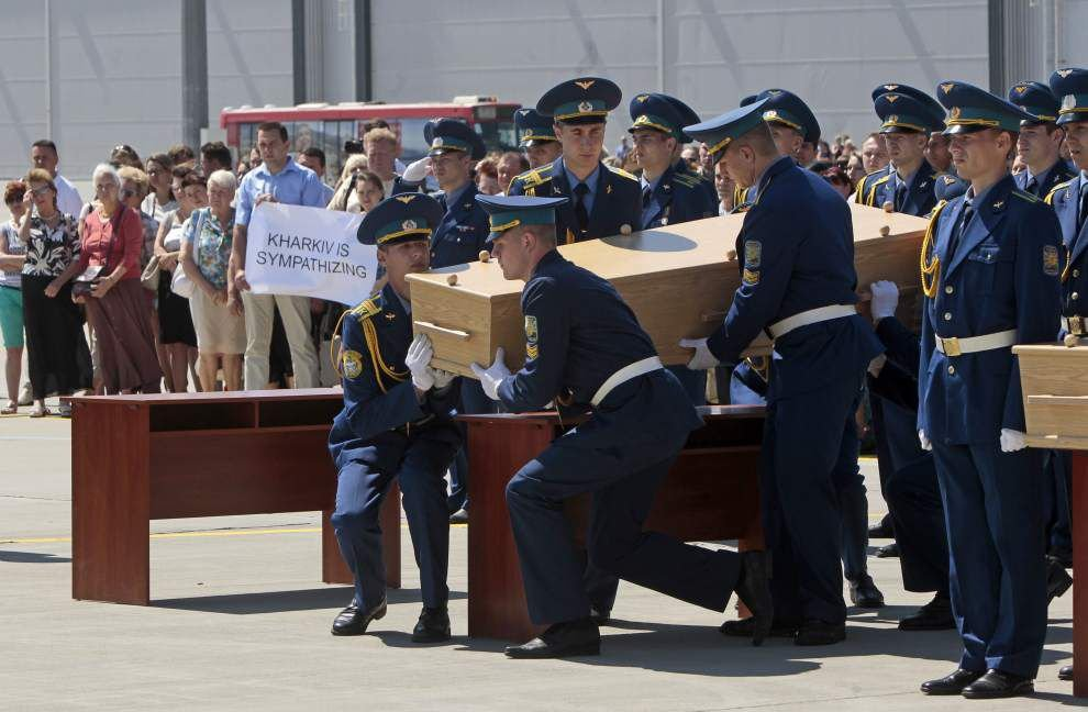 Bodies of Malaysia jet victims leave Ukraine _lowres