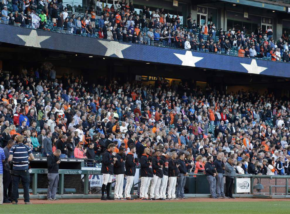 """MILWAUKEE — The late Darryl Hamilton was remembered with a moment of silence before Tuesday night's game between two of his former teams, the New York Mets and Milwaukee Brewers. Police on Monday said the 50-year-old Hamilton, a Baton Rouge native, was killed in a murder-suicide in a suburban Houston home. An initial investigation determined Hamilton was shot several times and that a woman in the home died of a self-inflicted gunshot wound. The former center fielder had worked for the MLB Network since 2013. Hamilton's 13-year major league career began in 1988 in Milwaukee, where he played all or parts of seven seasons. His career ended with the Mets in 2001. He was a member of the Mets team that reached the 2000 World Series. """"Major League Baseball has lost a true talent, and the Brewers have lost a true friend,"""" the Miller Park public address announcer said before the crowd fell silent.  Hamilton filled in as an analyst on Brewers radio broadcasts in 2014. He worked a few broadcasts with Craig Counsell, who replaced Ron Roenicke as Milwaukee's manager in May.  """"The thing I remember is he was a pretty good player and he had a smile on his face every time he was on the field,"""" Counsell said. """"He was always happy to be at the ballpark and in a good mood."""" _lowres"""