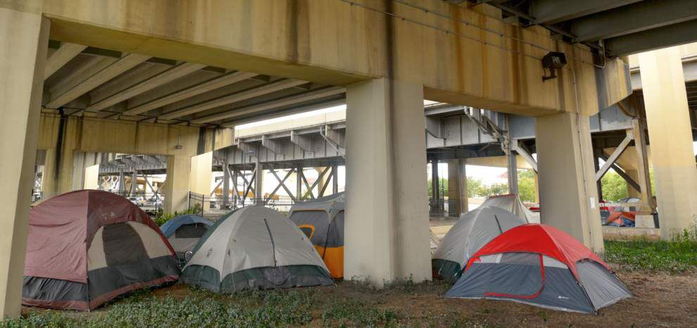 City gives notice to clear tents, furniture from under expressway _lowres