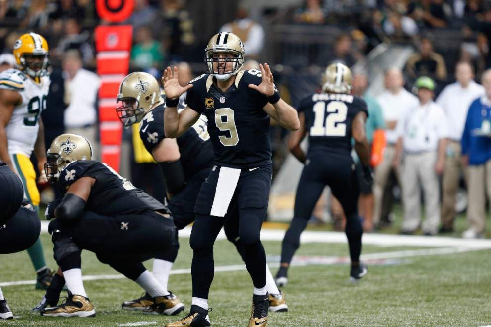 Saints quarterback Drew Brees becomes NFL's all-time leader in completion percentage _lowres