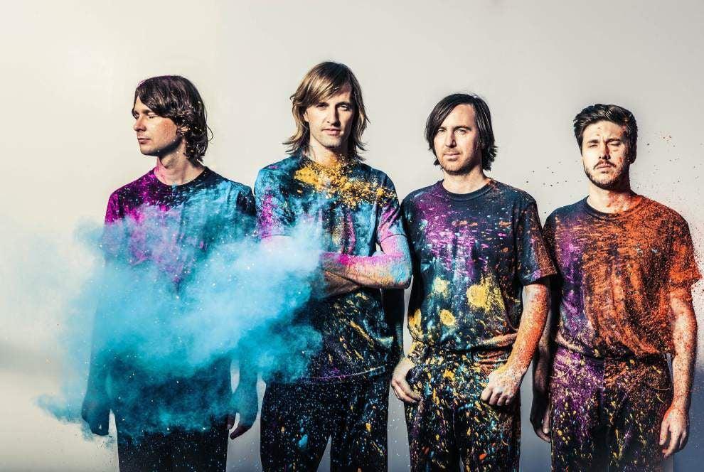 Australian electronic pop band Cut Copy keeps an eye on the soccer match _lowres