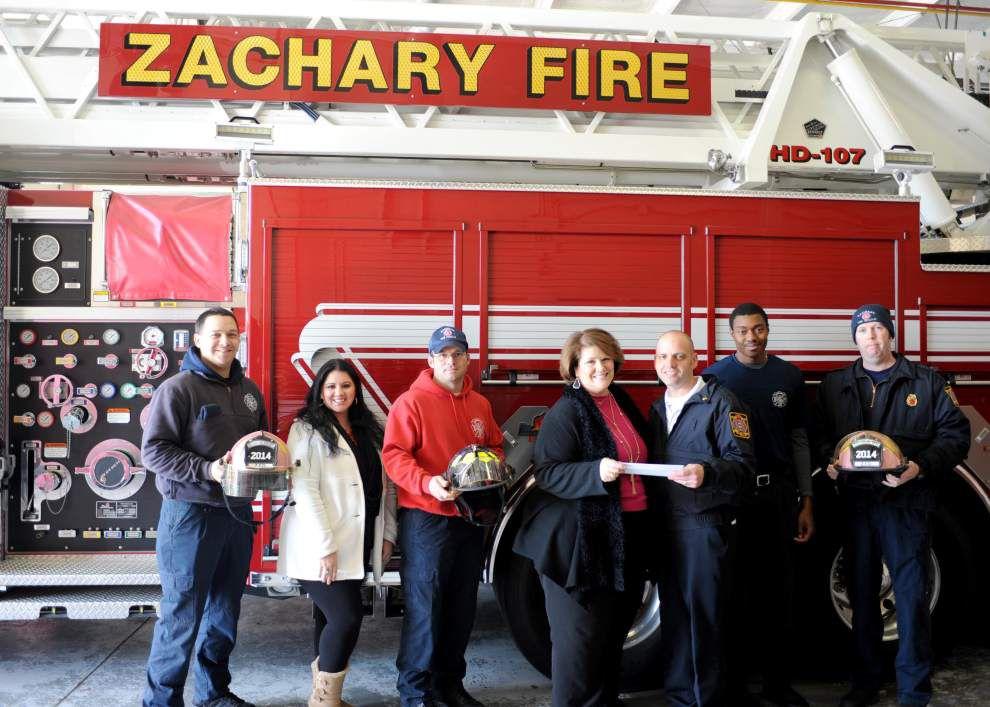 Fire Department donates to Susan G. Komen BR _lowres