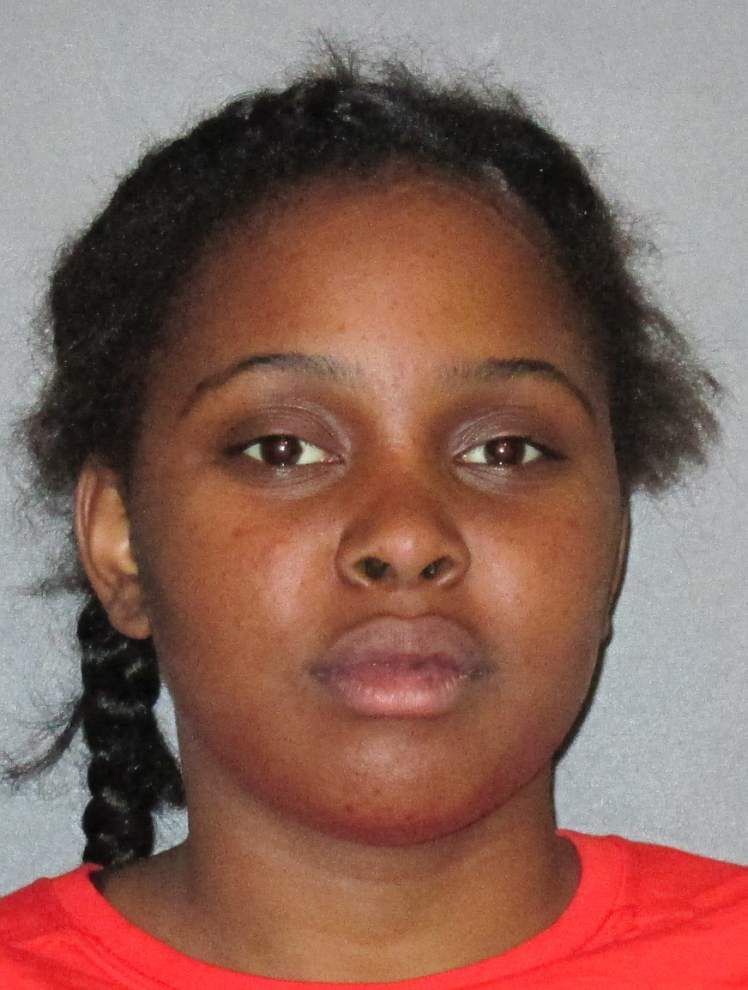 Police: Baton Rouge woman -- with unrestrained child -- rams car, punches and spits on driver _lowres