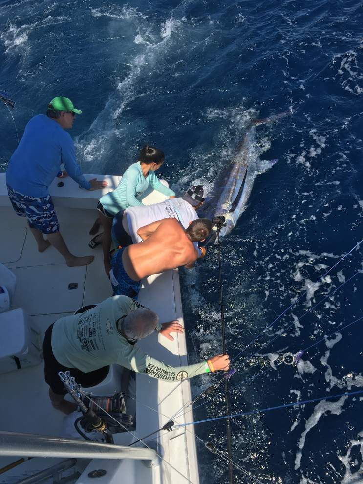 Notebook: Dad watches teenage daughter land first blue marlin, win Junior Angler award; rodeo director sees Swollfest swell _lowres