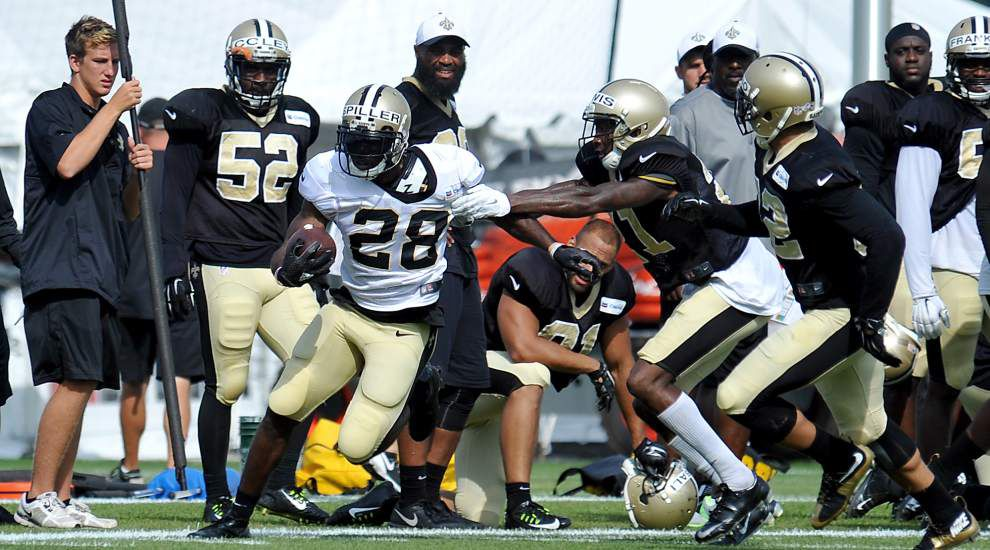 Saints' C.J. Spiller has plenty of help around him as he tries to restart his NFL career with the Saints _lowres