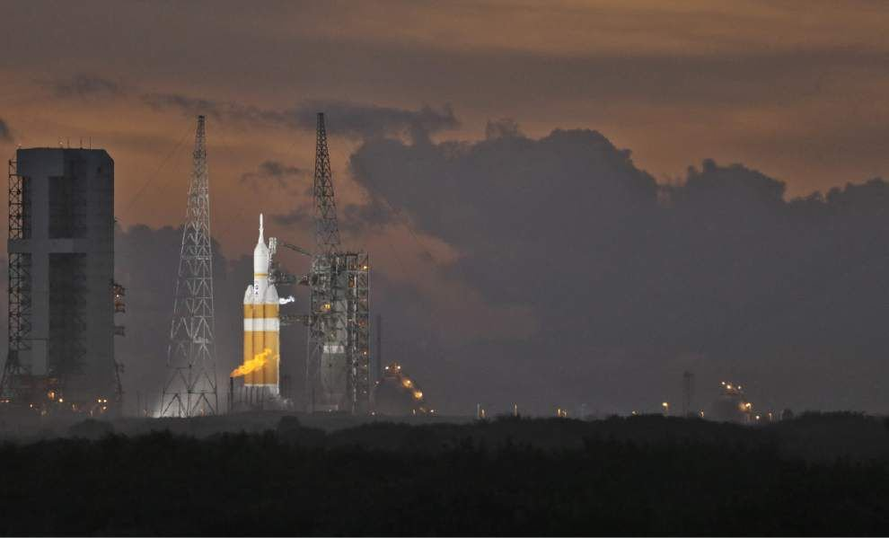 NASA scrubs Orion launch; will try again Friday _lowres