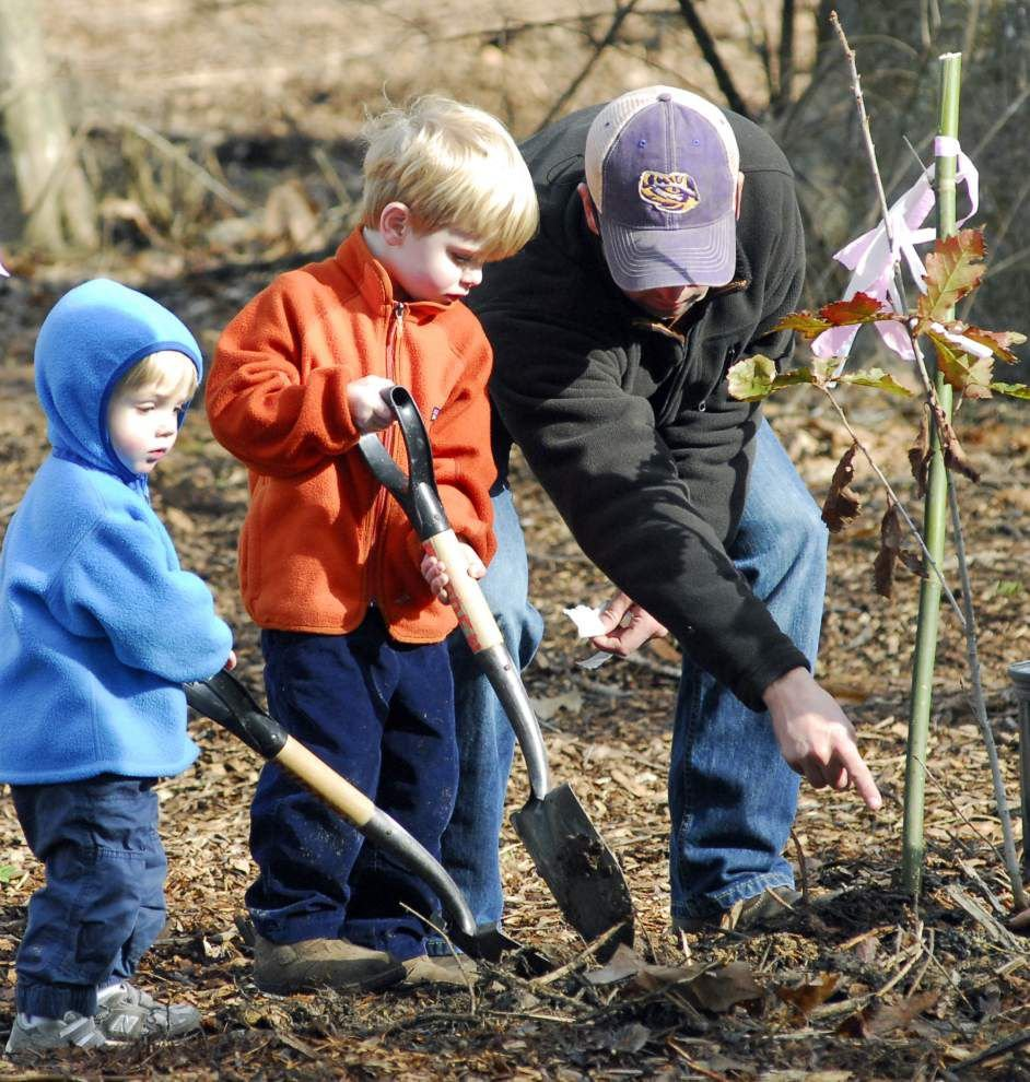 Tree planting a family affair, and tradition, at BR's Burden Center _lowres