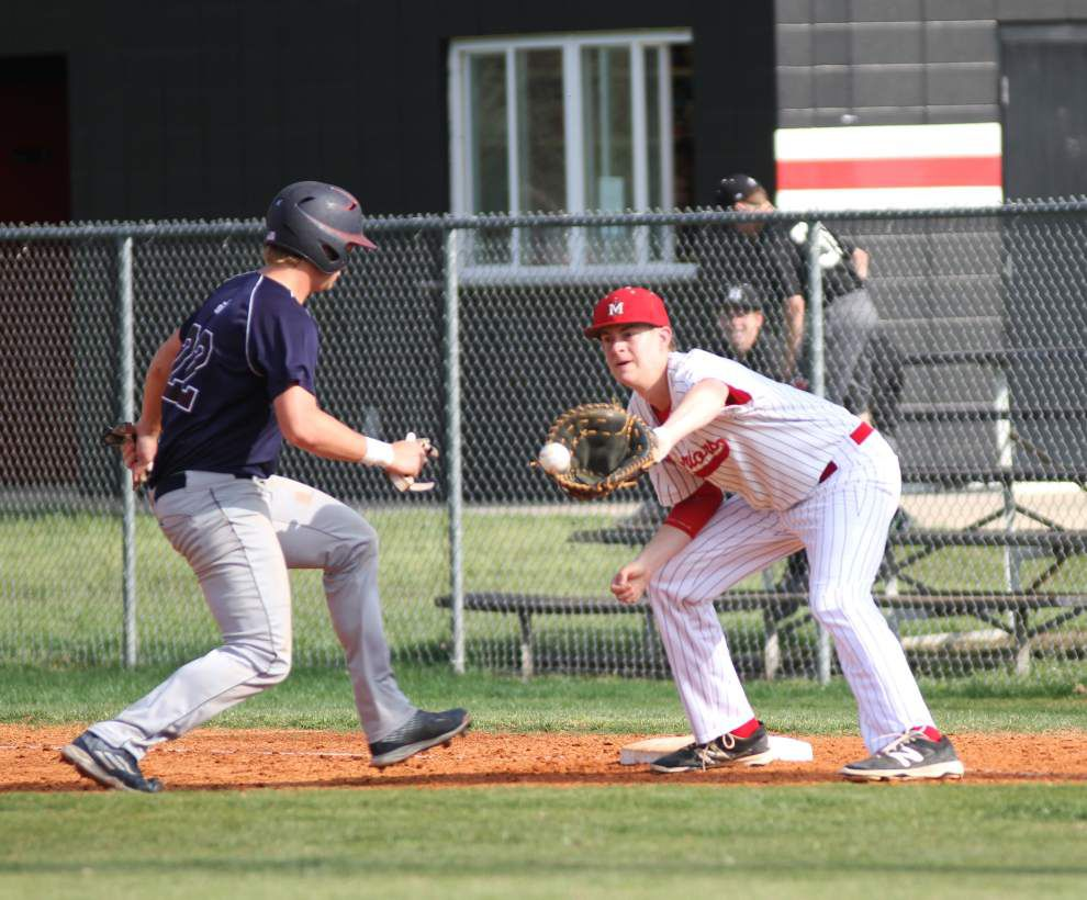 Big target, big bat: First baseman Michael Smith plays a key role for Class 4A semifinalist St. Michael _lowres