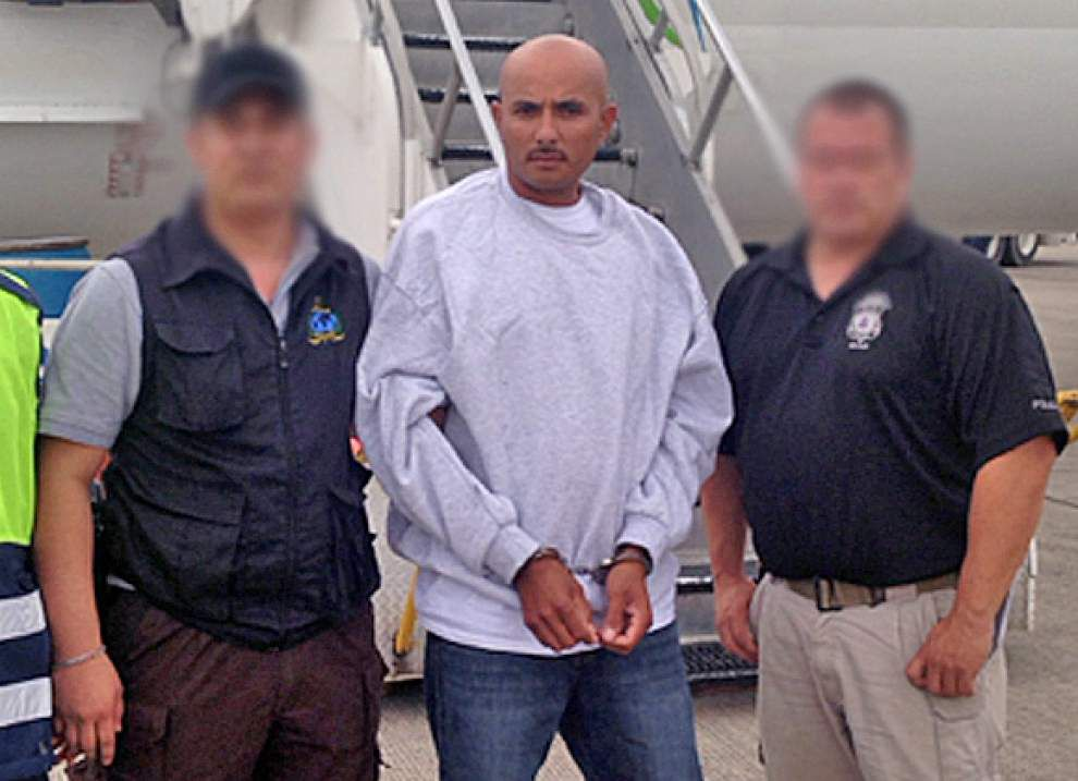 Honduran fugitive, arrested amid cries of racial profiling, deported on murder charge _lowres