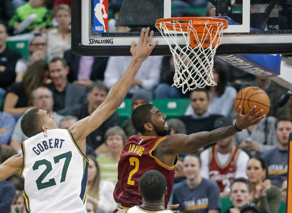 Jrue Holiday and Kyrie Irving square off as Pelicans visit LeBron James' Cavaliers on Monday _lowres