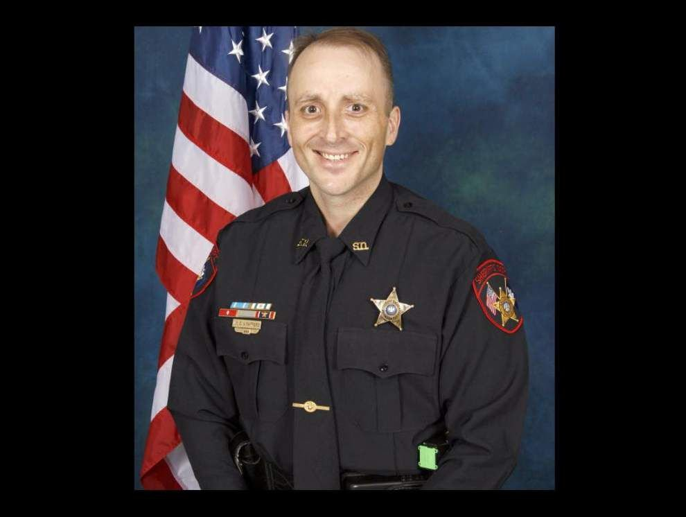 Ascension deputy pulls drowning toddler from pond _lowres