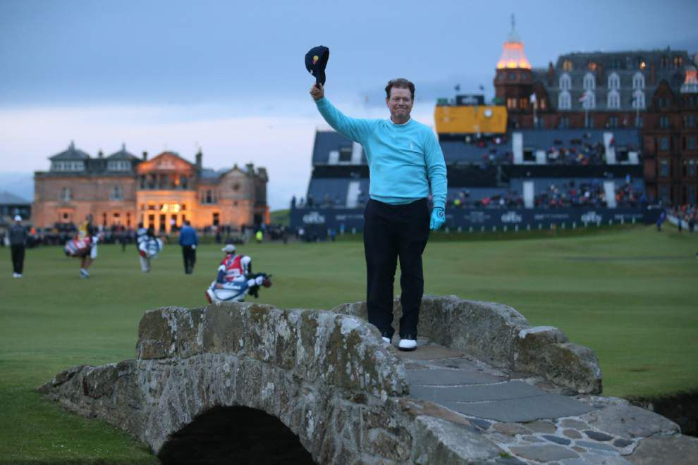 Tom Watson crosses Swilcan Bridge for final time _lowres