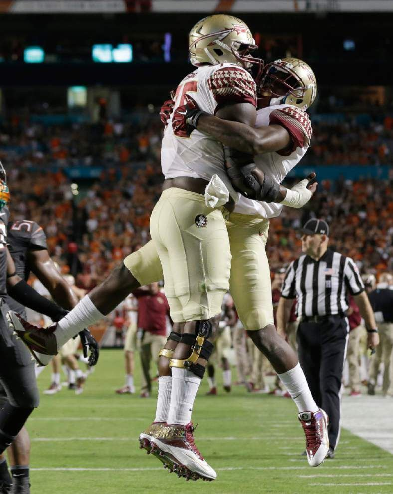 Florida State rallies again, tops Miami 30-26 _lowres