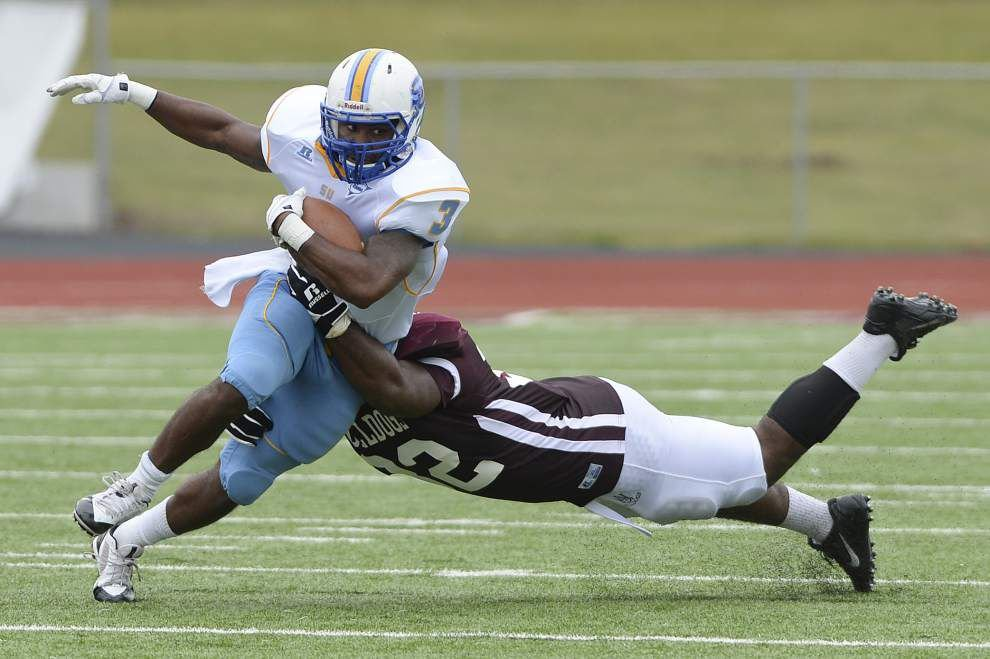 Southern climbs out of 20-point hole to top Alabama A&M 35-34 _lowres