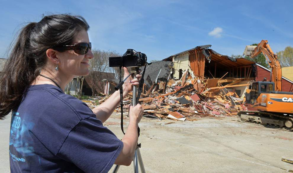 Bright red School Time Uniforms building in Bocage Village demolished Monday, but memories remain _lowres