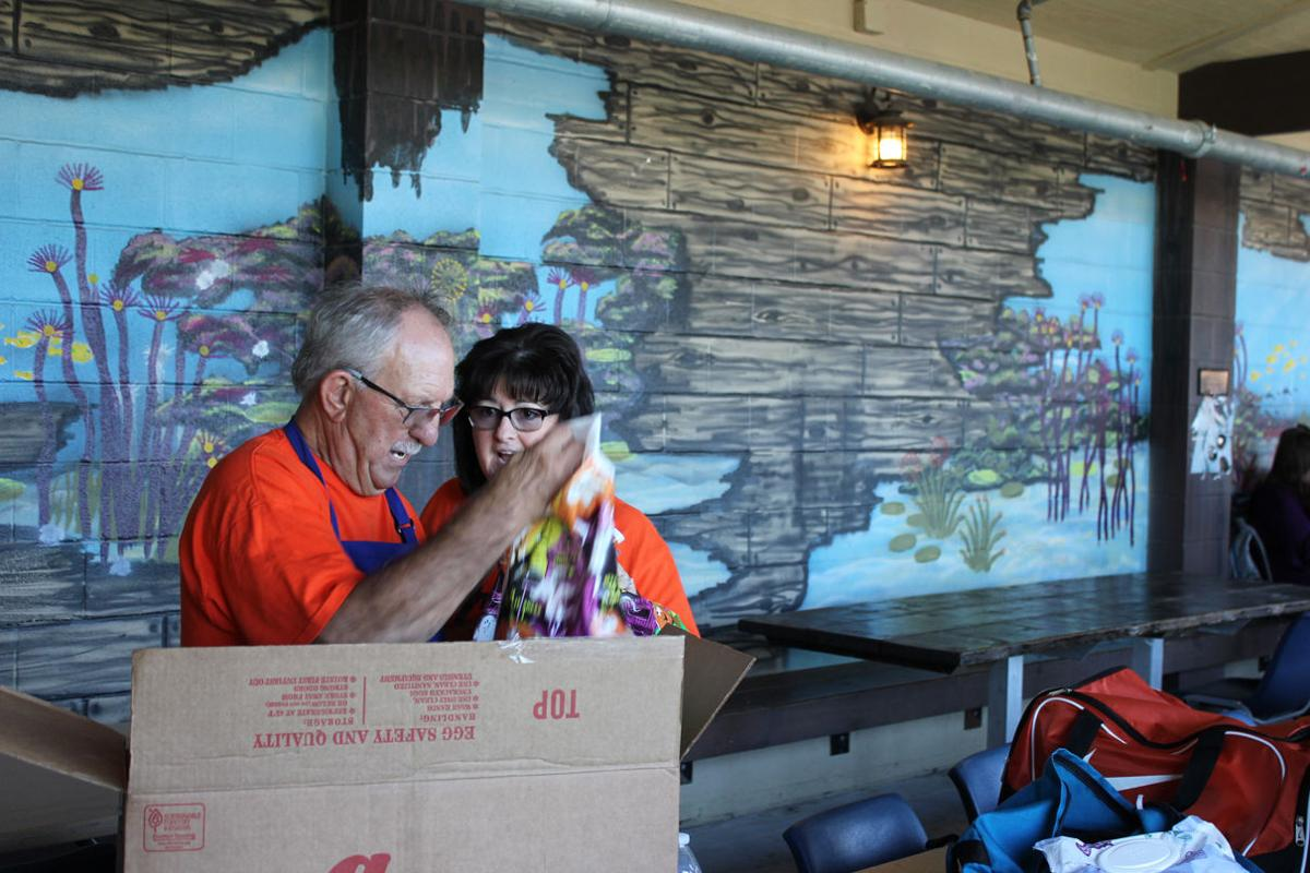 Mike and Joell Hebert help to distribute Halloween Candy at.JPG