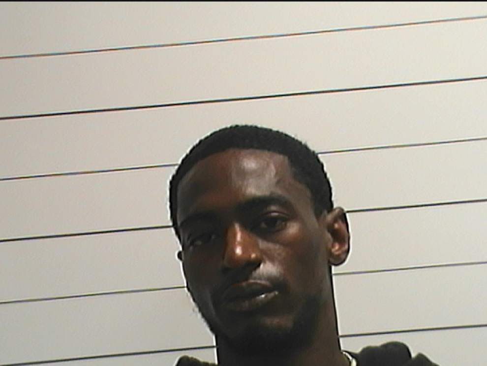 Masked man, armed with assault rifle and bulletproof vest, arrested in Mid-City robbery spree _lowres