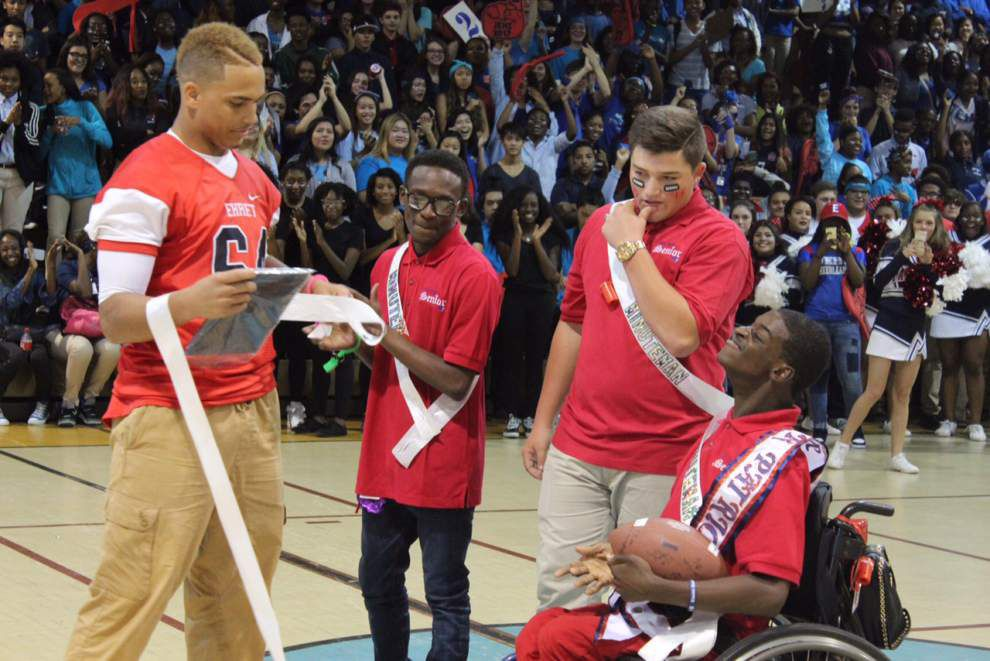 'The whole gym went crazy': John Ehret star athlete gives homecoming king crown to deaf classmate with cerebral palsy _lowres