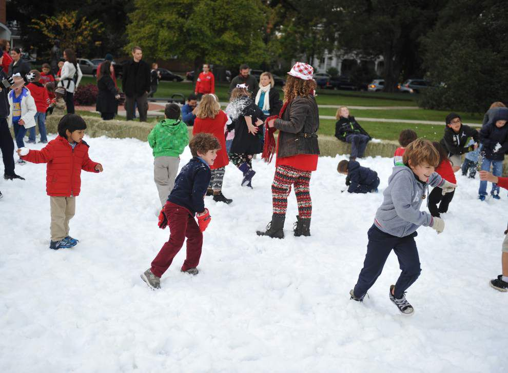 Photos: With some man-made help, annual Sneaux Day sees ice skating, snowballs _lowres