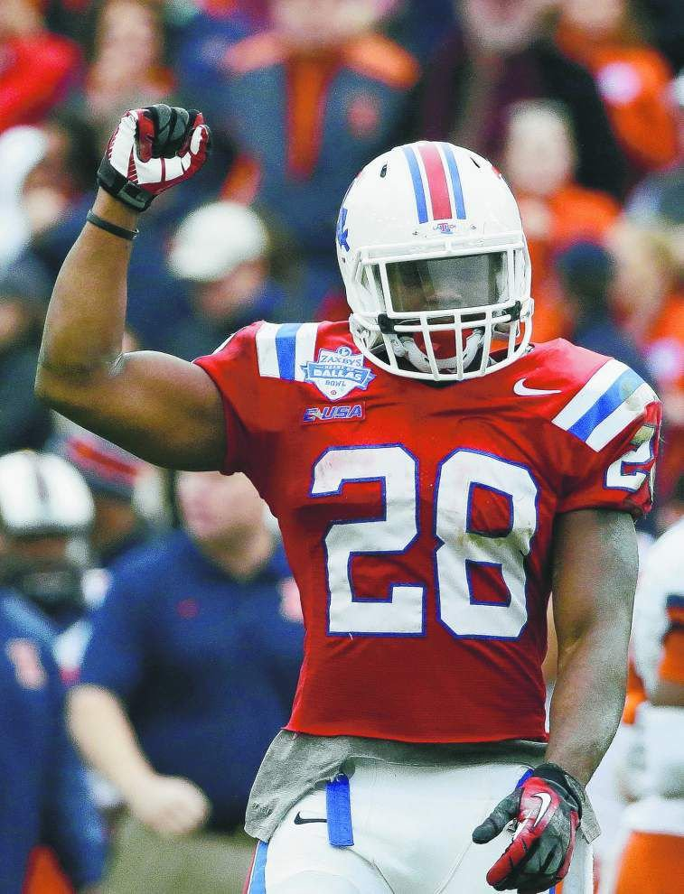 The touchdowns keep coming for Louisiana Tech standout Kenneth Dixon, but he's all about the team _lowres