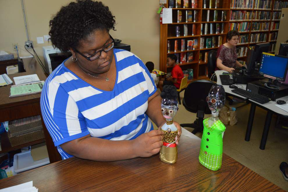Student shares vision for future via recycled robots _lowres