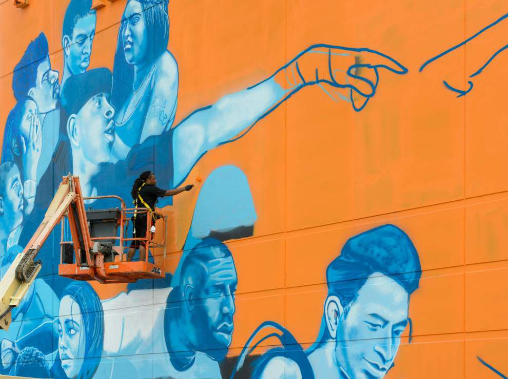 A Sistine Chapel for Interstate 10 takes shape in New Orleans East as artist paints massive peace mural _lowres
