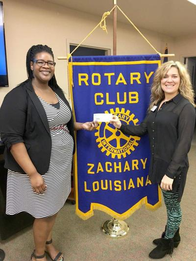 Rotary donation helps club attend convention _lowres